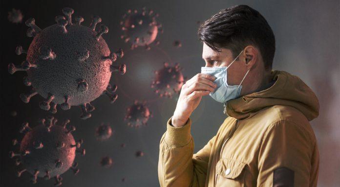 Montagem com ilustrações de vírus e um homem com máscara.